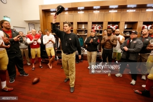 SANTA CLARA, CA - DECEMBER 20: Head Coach Jim Harbaugh of the San Francisco 49ers addresses the team in the locker room, for the last time, following the game against the Arizona Cardinals at Levi Stadium on December 28, 2014 in Santa Clara, California. The 49ers defeated the Cardinals 20-17. (Photo by Michael Zagaris/San Francisco 49ers/Getty Images)  *** Local Caption *** Jim Harbaugh