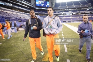 Football: NFL Scouting Combine: (L-R) Florida State QB Jameis Winston (QB15) and Oregon QB Marcus Mariota (QB11) on field before drills at Lucas Oil Stadium. Indianapolis, IN 2/21/2015 CREDIT: Todd Rosenberg (Photo by Todd Rosenberg /Sports Illustrated/Getty Images) (Set Number: X159260 TK4 )