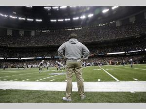 New England Patriots head coach Bill Belichick watches from the sideline in the first half of Saturday's preseason game against the New Orleans Saints in New Orleans, Saturday, Aug. 22, 2015. (AP Photo/Brynn Anderson)