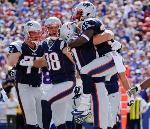New England Patriots' Dion Lewis, right, celebrates with Rob Gronkowski (87) after rushing for a touchdown during the first half against the Bills, (AP Photo/Bill Wippert)