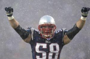 FOXBORO, MA - JANUARY 18: Linebacker Matt Chatham #58 of the New England Patriots celebrates against the Indianapolis Colts in the AFC Championship Game on January 18, 2004 at Gillette Stadium in Foxboro, Massachusetts. (Photo by Ezra Shaw/Getty Images)