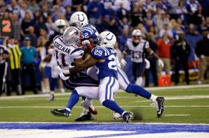 Julian Edelman scores as he's hit by Colts strong safety Mike Adams (29) and inside linebacker D'Qwell Jackson (52) . (AP Photo/AJ Mast)