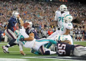 10-29 Ninkovich hits Tannehill (Photo: Keith Nordstrom Patriots.com)