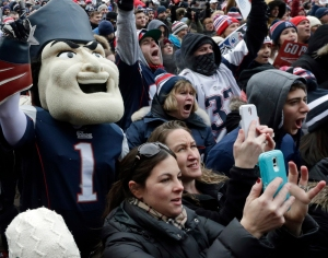 New England Patriots mascot Pat Patriot, and fans cheer during an NFL football send-off rally at City Hall in Boston (AP Photo/Charles Krupa)