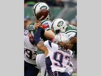 Jabaal Sheard (93) strips the ball from New York Jets quarterback Ryan Fitzpatrick (14) (AP Photo/Seth Wenig)