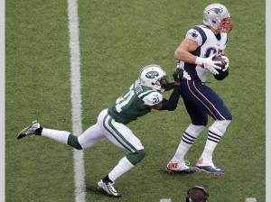 No one takes Rob Gronkowski (87) down one on one ( New York Jets' Antonio Cromartie (31) (AP Photo/Peter Morgan)