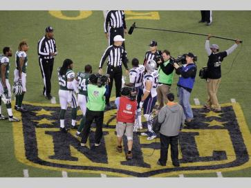 The officials meet New York Jets' Darrelle Revis (24), teammate Calvin Pryor (25) and New England Patriots' Matthew Slater (18) and teammate Rob Ninkovich (50) for the coin toss before the overtime period resulting in highly questionable Patriots decision (AP hoto/Peter Morgan)