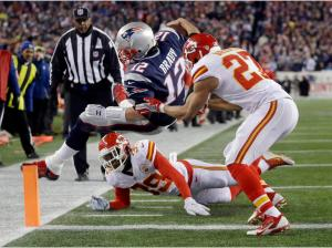 Kansas City Chiefs free safety Husain Abdullah (39) and defensive back Tyvon Branch (27) push Tom Brady (12) out of bounds short of the goal line (AP Photo/Steven Senne)