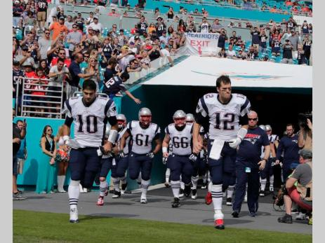 Entering the stadium you didn't see the usual fire in Tom Brady's eyes (Photo: AP Lynne Sladky)
