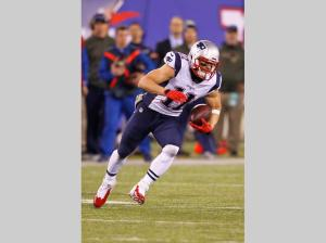 Julian Edelman broke his foot in this game against the Giants (AP Photo/Gary Hershorn)
